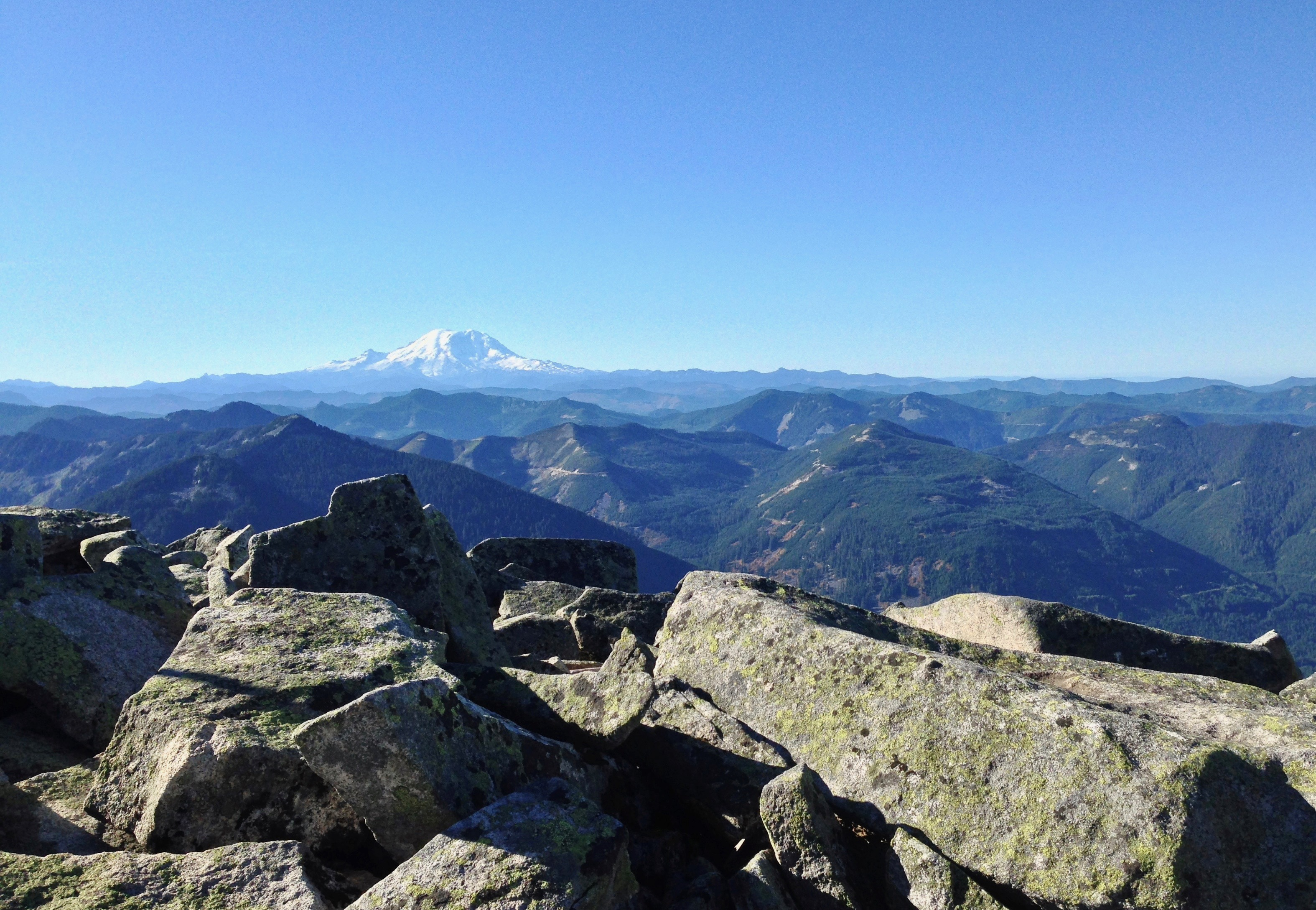 From Granite Mountain's jumbled stones, the view skims a crinkled landscape topped by Mt. Rainier on the southern horizon. Granite Mountain Trail, October 05, 2014.