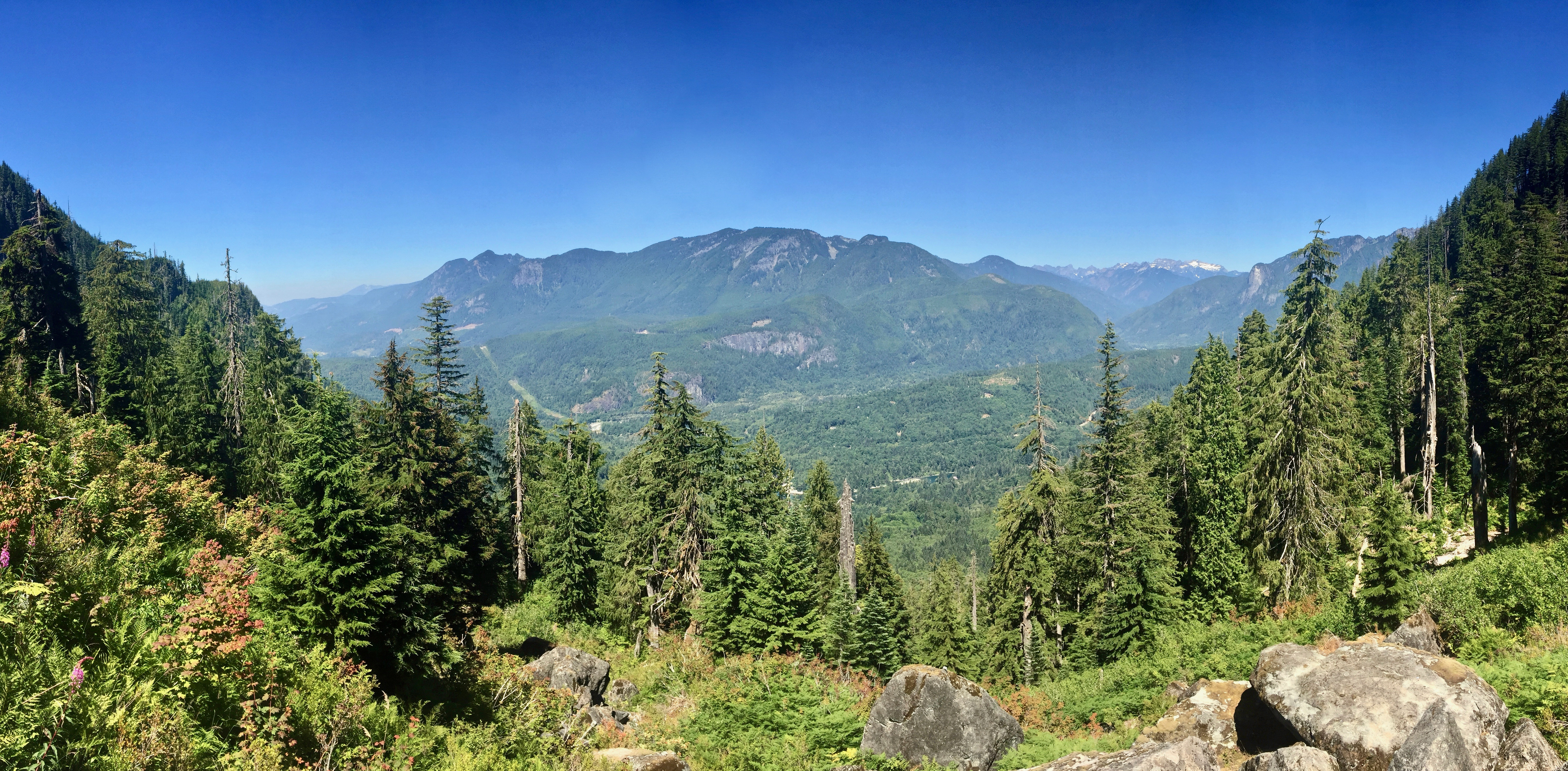 From boulder-strewn forest clearings near the lake, views stretch across the Skykomish River Valley below. Lake Serene Trail, July 31, 2017.