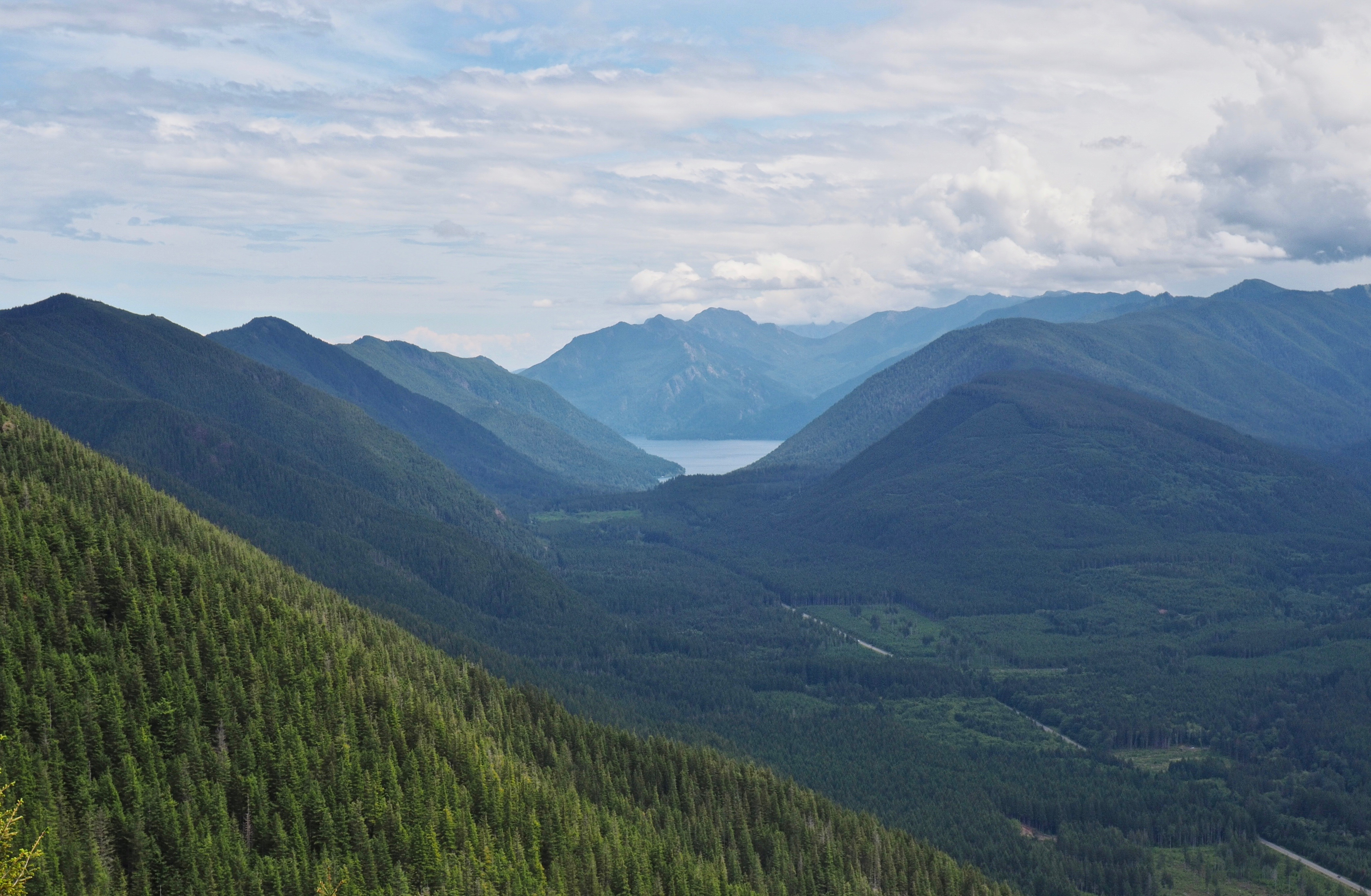 In the lookout's eastern view, Lake Crescent lies cradled in its mountain fold. Mount Muller lies midway down the ridge on the left and can be reached by taking the Snyder Ridge Trail from the North Point Loop that begins just below Kloshe Nanitch. Kloshe Nanitch Trail, June 17, 2016.