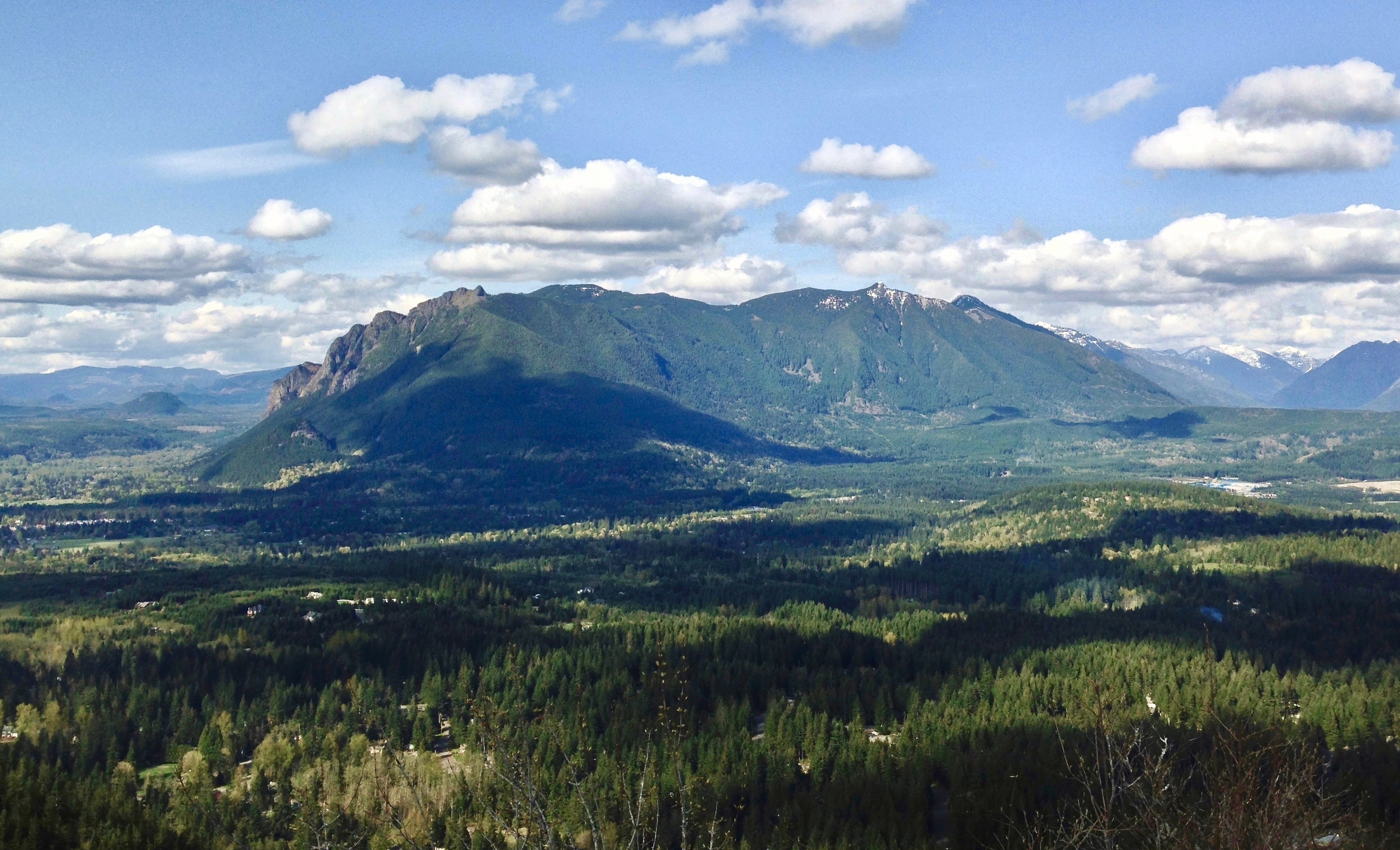 Mount Si and Mount Teneriffe rise to the north across the cloud-dappled Snoqualmie River Valley from Rattlesnake Ledge. Rattlesnake Mountain Trail, April 26, 2014.