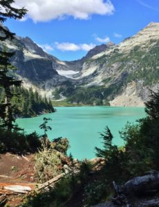 In noonday sun, Blanca Lake shimmers in its signature turquoise hue. Blanca Lake Trail, August 07, 2015.
