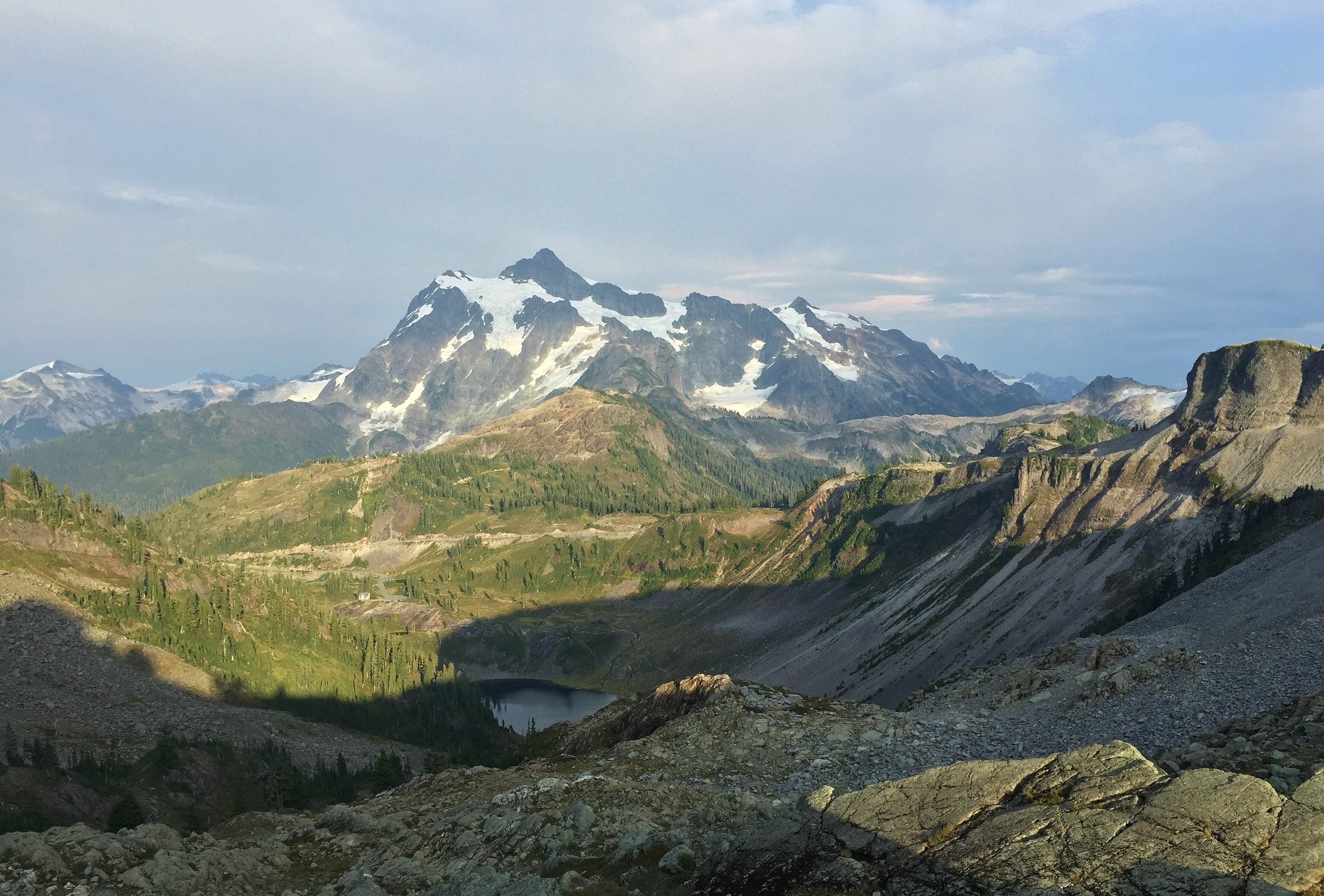 In the view from the Herman Saddle, Mount Shuksan basks in day's falling light. Chain Lakes Loop, August 10, 2015.