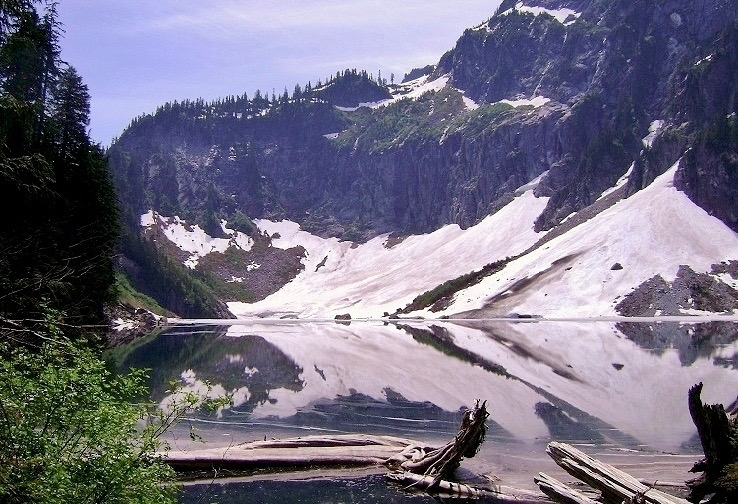Across the feet of Mount Index, snow often lingers into summer, combining with its own reflection to create abstract patterns along the lakeshore. Lake Serene Trail, July 04, 2009.