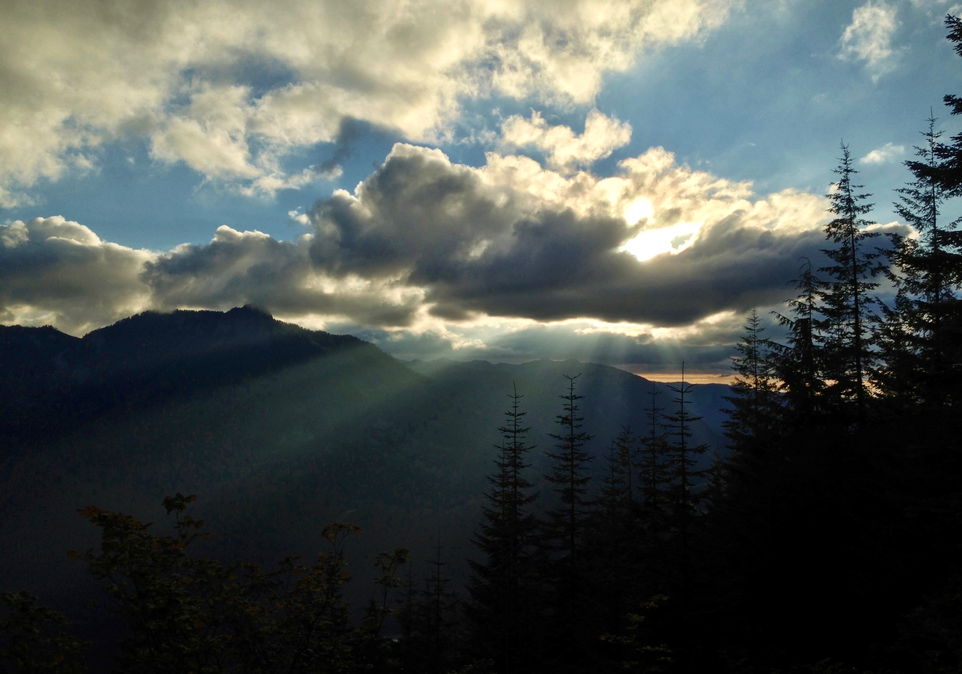 Day's last splendor bursts over McClellan Butte and Mount Washington. Ira Spring Trail, August 18, 2013.